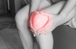 A women with pain in knees that could be prevented with food for women in menopause