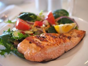 Meal with green vegetables and salmon