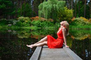 Women relaxing near by water