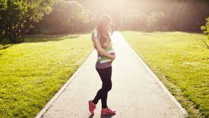 A pregnant woman walking