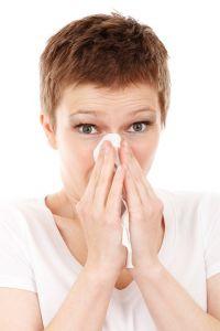 A woman sneezing