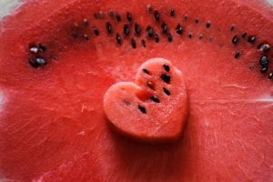 A piece of watermelon in shape of the heart