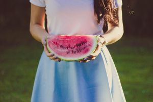 A girl with a piece of watermelon